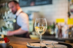Glass of Wine on the Bar at The White Hart Hotel, Eatery and Coffee House, Boston